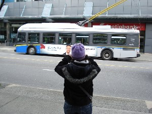 Chelsea taking a photo of a bus